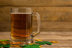 Mug of beer, chocolate gold coins and shamrock for St Patricks Day Stock Image