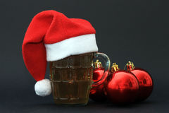 Mug of beer and Christmas balls Royalty Free Stock Photos