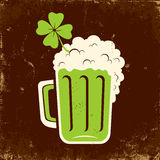 Mug of beer and clover Royalty Free Stock Images