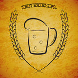 Mug beer with ears of wheat on grunge yellow background Stock Images