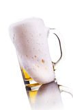 Mug of beer with foam Stock Photography