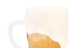 Mug of beer with foam close-up. On a white background Stock Photography