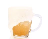 Mug of beer with foam. On a white background Stock Image
