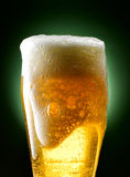 Mug of beer. Foamy beer poured into the jug Stock Photos