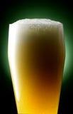 Mug of beer. Foamy beer poured into the jug Stock Photography