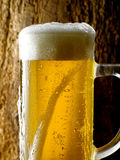 Mug of beer. Foamy beer poured into the jug Royalty Free Stock Image