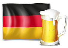 A mug with  beer in front of the German flag Stock Photos