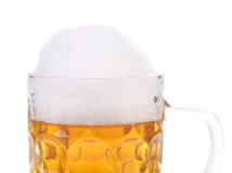 Mug of beer with froth. Stock Images