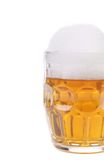 Mug of beer with froth. Royalty Free Stock Image