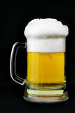 Mug of beer with froth Stock Images