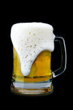 Mug of beer with froth Royalty Free Stock Photos