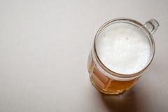 Mug of beer on gray Stock Image
