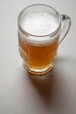 Mug of beer on gray Royalty Free Stock Photos