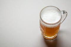 Mug of beer on gray Royalty Free Stock Image