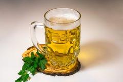 A mug of beer, green parsley. royalty free stock image