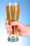 Mug of beer in hand Stock Photo