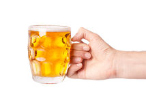 Mug of beer in hand Stock Photography