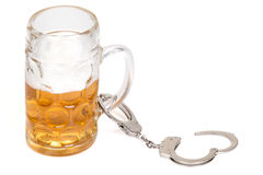 Mug of beer with handcuffs Royalty Free Stock Photography