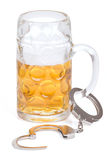 Mug of beer with handcuffs Stock Image