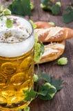 Mug of Beer with hop (macro shot). On wooden background Stock Image