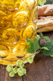 Mug of Beer with hop (macro shot). On wooden background Royalty Free Stock Photo