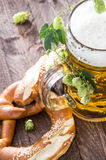Mug of Beer with hop (macro shot). On wooden background Royalty Free Stock Photography