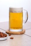 Mug of beer and nuts stock image