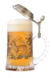 Mug of beer with path. Souvenir glass with the image of the wild nature, filled by beer, with the slightly opened cover Royalty Free Stock Images
