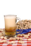 Mug of beer with peanuts Stock Image