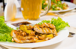 Mug of Beer on Restaurant Table with Plated Food Royalty Free Stock Photo