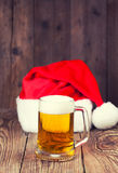 Mug of beer with Santa's hat Stock Photo