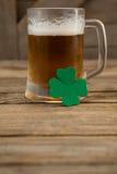 Mug of beer and shamrock for St Patricks Day Stock Images