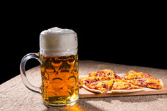 Mug of Beer and Slices of Pizza on Cutting Board Stock Image