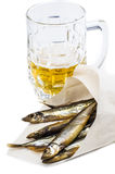 Mug of beer with smoked fish. On a white background Stock Image