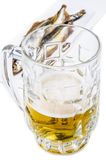Mug of beer with smoked fish. On a white background Royalty Free Stock Photos