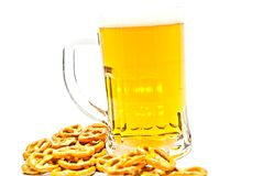 Mug of beer and some crackers Royalty Free Stock Images