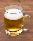 Mug of beer on wood Royalty Free Stock Photography