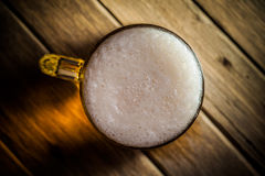 Mug of beer. On wooden background Stock Photos
