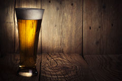 Mug of beer. On wooden background Stock Image