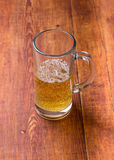 Mug of beer on wooden  background Royalty Free Stock Photography