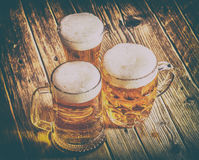 Mug of beer. On wooden background Royalty Free Stock Photo