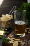 Mug of beer on wooden background Stock Photos