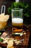 Mug of beer on wooden background. Mug of cold beer on wooden background Royalty Free Stock Photos
