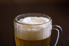 Mug of beer on wooden background Stock Images