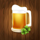 Mug of beer on a wooden background Stock Photography