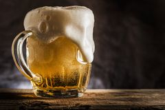 Mug of beer. On wooden table royalty free stock photography