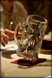 Mug of beer. On wooden table stock photography