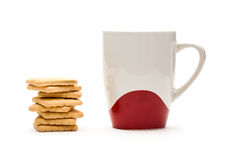 Mug and biscuits Stock Images