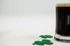 Mug of black beer and shamrock for St Patricks Day Royalty Free Stock Photo