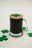 Mug of black beer and shamrock for St Patricks Day Stock Photo